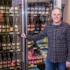 Hickenlooper signs bill to slowly allow grocery store wine, beer sales