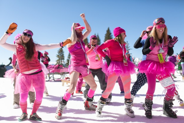 "Team ""revolution power yogis"" dance during a snow yoga session at Vail's Wildwood Saturday during the 4th annual Pink Vail ski day to conquer cancer.  Over half a million dollars was raised by the event."